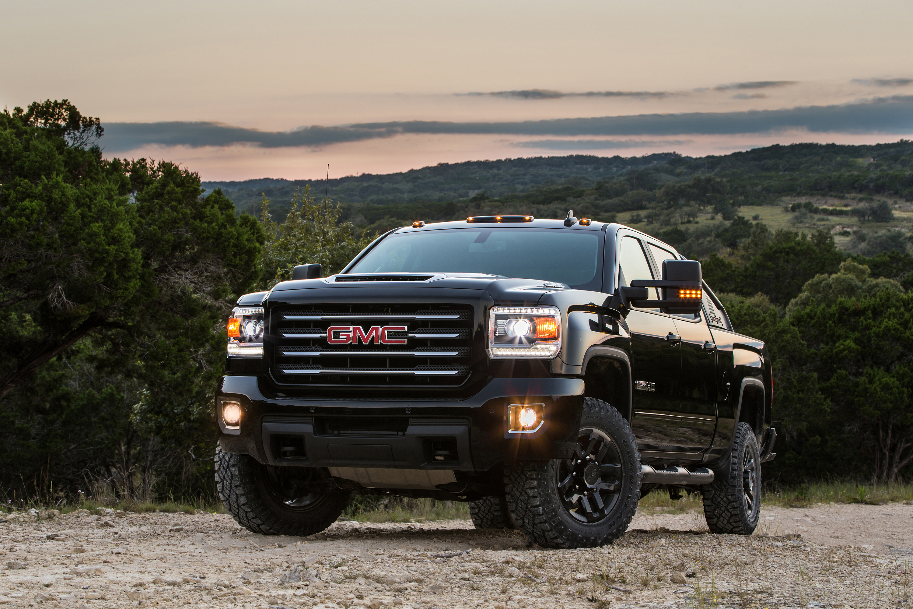 meaner gmc allterrainx new hd gets edition driving x up terrain all auto package toughens with sierra news