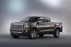 2015 GMC Canyon SLT Crew Cab Long Bed Front Three Quarter in Bronze Alloy Metallic - in studio