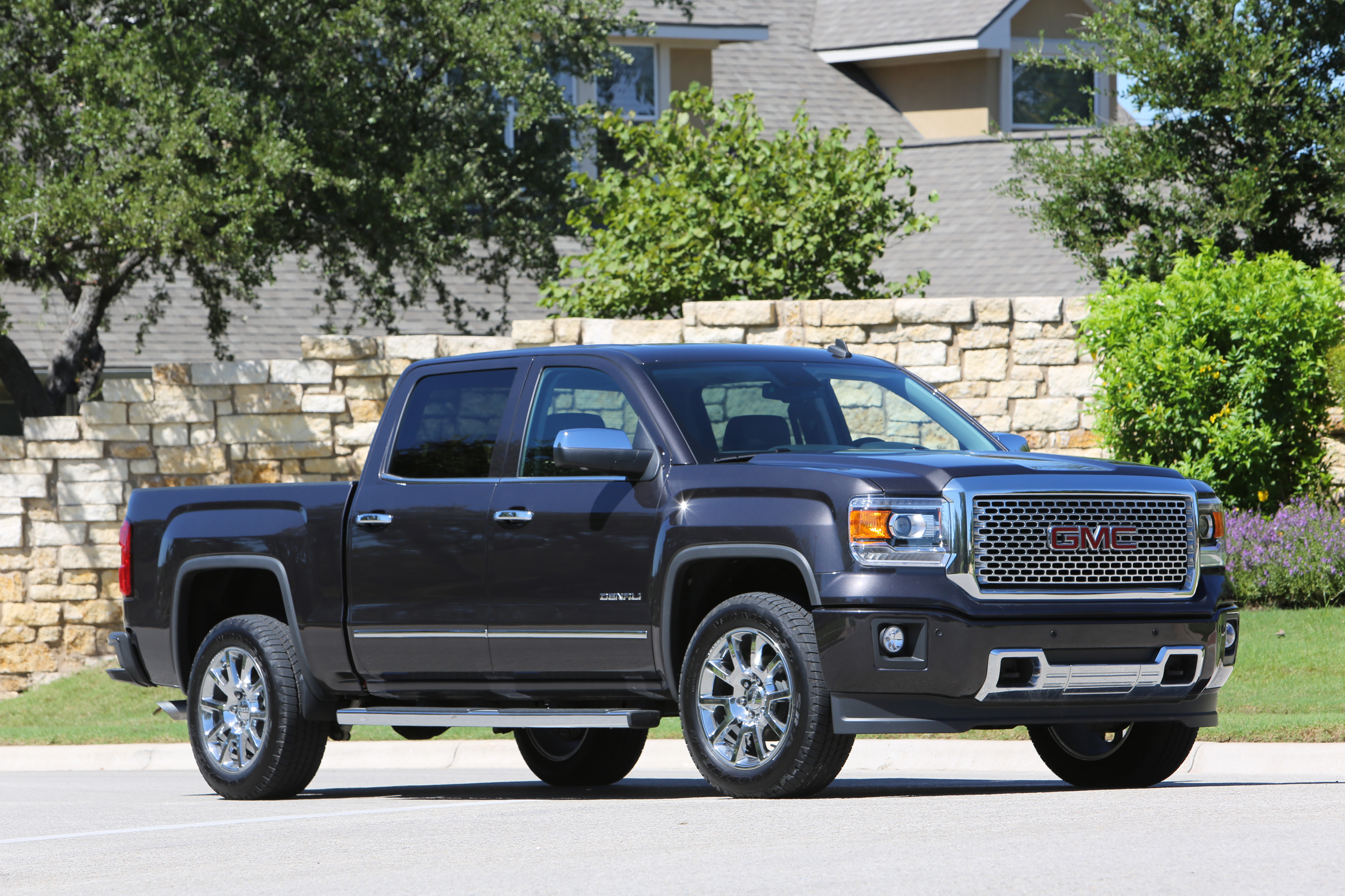 daily luxury gmc silverado the denali range sierra meet consumer gets topping guide high sibling chevy country a drive